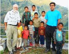 Rohan with Dr. Joseph Alter and kids in a village.