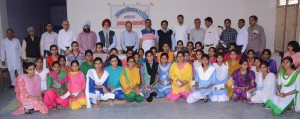 A group picture of all the girls in the school receivng support from IFCARE taken on the annual day function of the NGO. The adults standing in the back are the board members of IFCARE and some of the parents of the girls in the school.