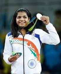 "Sakshi Malik after winning her Bronze for wrestling in the 2016 Olympics. Look at her gleeful, joyous smile! In the Indian context, Sakshi, like the other winner Sindhu, is not ""fair."" But she is not just ""lovely,"" but gorgeous."